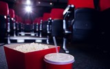Empty rows of red seats with pop corn and drink on the floor - 81225532