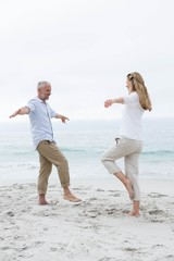 Happy couple doing yoga pose