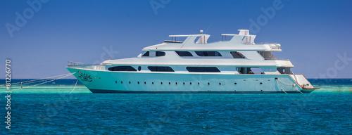 Leinwandbild Motiv  yacht on a background of blue sea