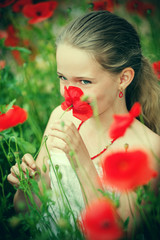 Pretty girl portrait with poppies