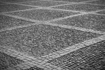 Old town background - Stockholm cobbles. Black and white.
