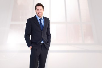 Young businessman with hands in pocket