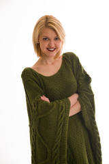 Woman in a sweater smiling on a white background