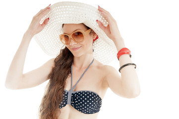 Beautiful summer girl wearing hat and sunglasses on white backgr