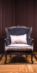 elegant black sitting chair with white pillow and wooden frame