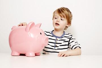 Boy with large piggybank