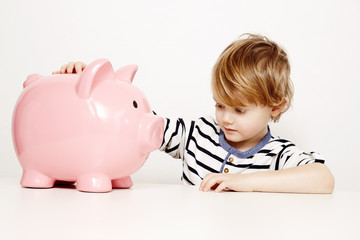 Boy with large piggybank