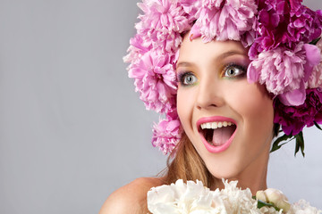 Girl with peonies in her hair. Beautiful model