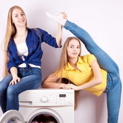 Two girls and a washing machine