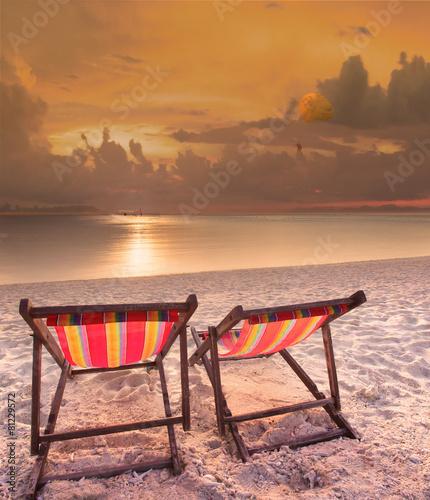 Leinwanddruck Bild couples of wood chairs beach at sea side and parashoot ship play