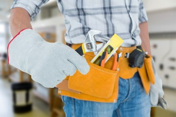 technician using adjustable wrench against white background
