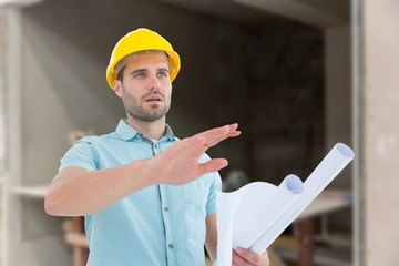 architect with blueprint gesturing on white background