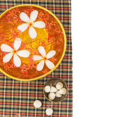 Songkran festival - Bowl of water with flowers