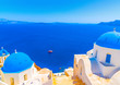 churches with blue domes in Oia at Santorini island in Greece - 81230371