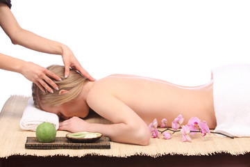 Close up of hands massaging a woman's forehead at beauty spa