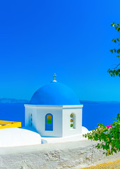 blue dome from a  church in Oia of Santorini island in Greece