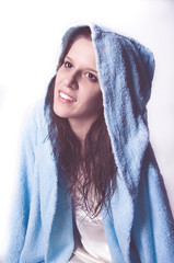 beautiful young woman posing with a blue bathrobe