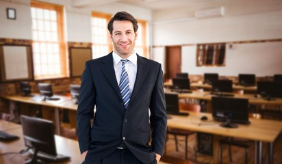 Businessman standing with hands in pocket