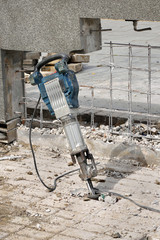 Construction site demolish with electric plugger, chisel, hammer