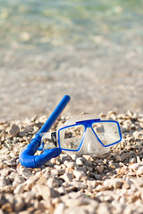 diving mask glasses and pipe at summer beach