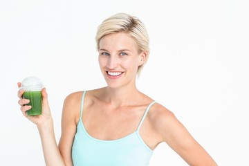 Beautiful woman holding green juice