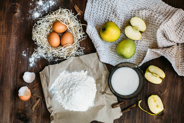Charlotte cake ingredients on wood table