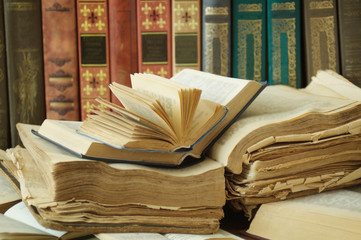 Opened books lying on the bookshelf