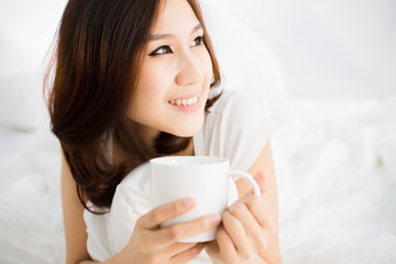 Portrait of a beautiful young woman in bed