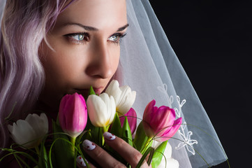 woman face with a bouquet of tulips