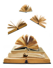 Book pile with open books flying away