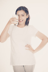 Laughing young woman with a glass of milk