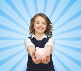 happy girl holding piggy bank on palms
