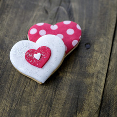 Gingerbread heart  on rustic wooden background.