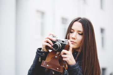 Portrait of a beautiful adult sensual woman with camera.