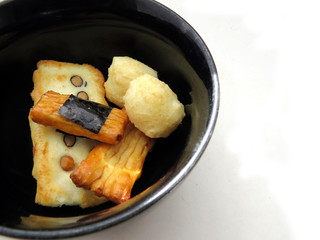 Japanese rice crackers in black bowl