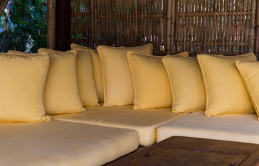 couch with pillows at hotel terrace