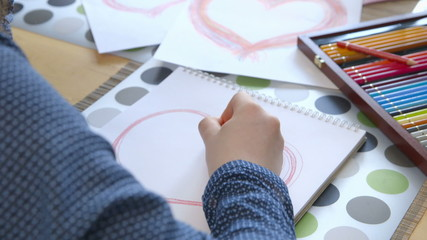 Girl drawing a heart - Valentine's Day - Mother's Day