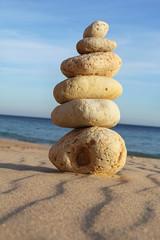 pebble stack on sandy beach