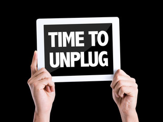 Tablet pc with text Time To Unplug isolated on black background