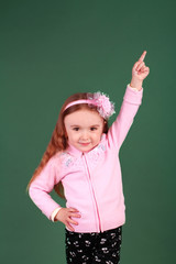 little girl pointing upward