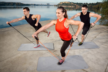 people training with resistance band