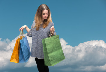 Sale. Young woman with shopping bags