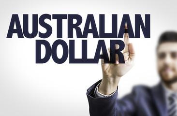 Business man pointing the text: Australian Dollar
