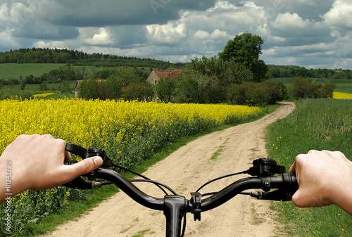 Bike riding on a dirt road. First person view. - 81242730