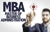Business man pointing the text: MBA poster
