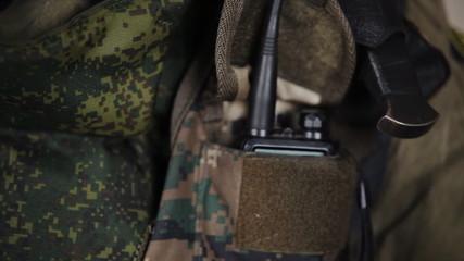 commando puts it in his pocket radio