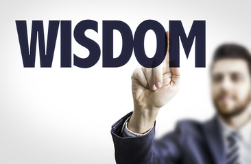 Business man pointing the text: Wisdom