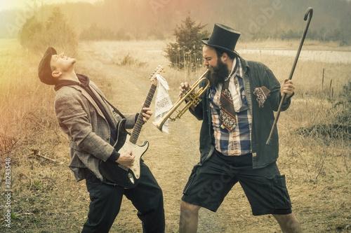 Leinwanddruck Bild Gypsy Trumpet and Guitar