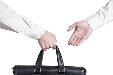 business transfer deal. handover of a suitcase for partners