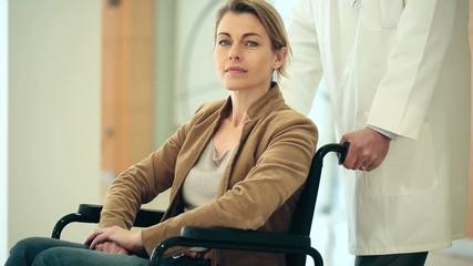 Sad mature woman sitting in wheelchair
